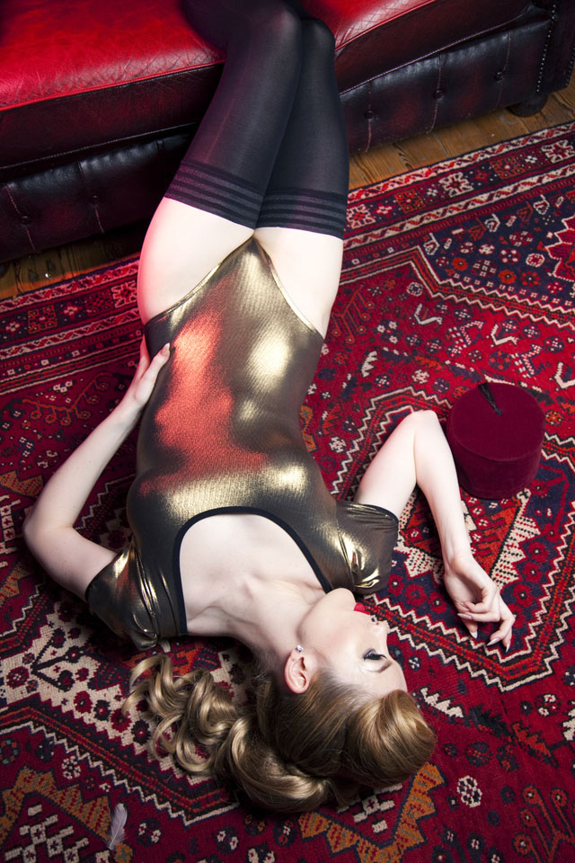 Playful Promises dazzle body in old gold